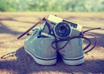 Vintage camera isolate with Sneakers