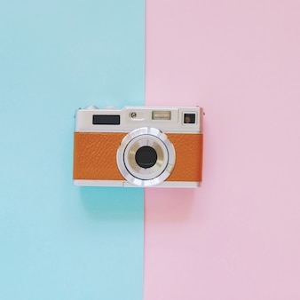 Vintage camera look on pink and blue background, minimal style