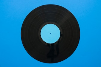 Vintage music concept with vinyl on blue background