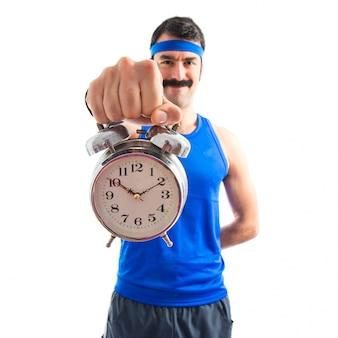 Vintage sportman holding a clock