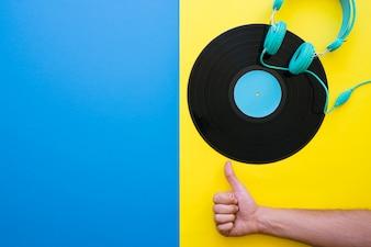 Vinyl and hand making okay gesture