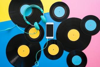 Vinyls, smartphone and headphones