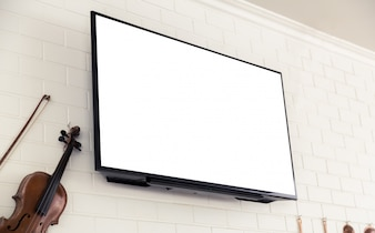 Violin next to a blank television screen