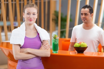 Waiter looking at sportswoman woman