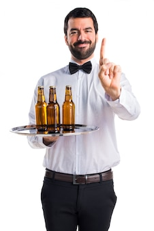 Waiter with beer bottles on the tray counting one