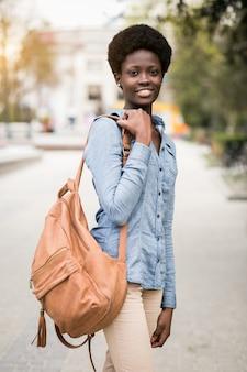 Walking american woman phone african