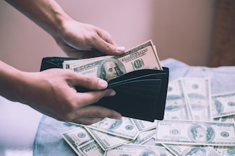Wallet buy debt pay closeup