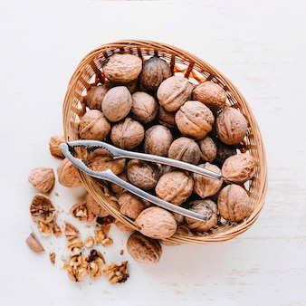 Walnuts in basket with nut mill