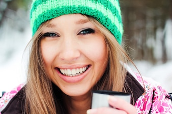 Warm model front cheerful snowboarder