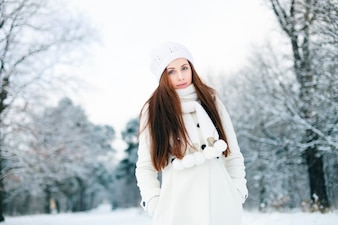 Warm woman in the snowy forest