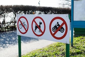 Warning Signs prohibiting bike, motorcycle and dog walking