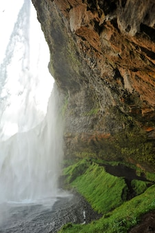 Waterfall falling on some rocks