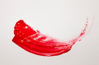 Wavy red paint stain