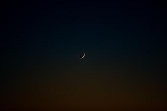 Waxing moon on black sky