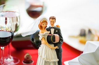 Wedding dolls holding a bottle
