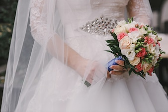 Wedding dress and bouquet of flowers