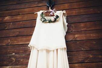 Wedding dress hanging from a hanger