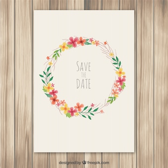 Wedding invitation with floral wreath