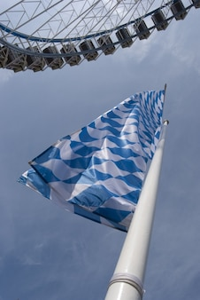 White and blue flag on blue background
