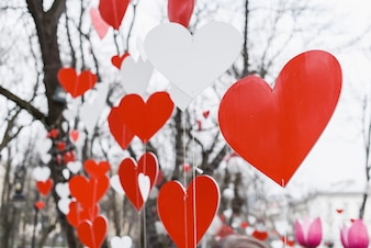 White and red hearts hanging on ropes