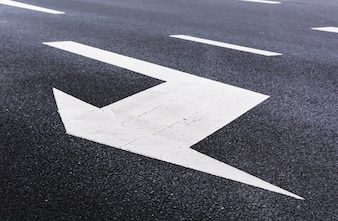 White arrow on the road