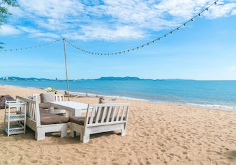 White chairs and table on beach