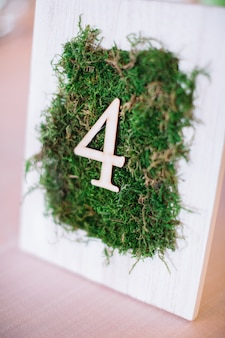 White frame with green grass and number 4 on it