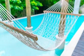 White hammocks in Luxury swimming pool .