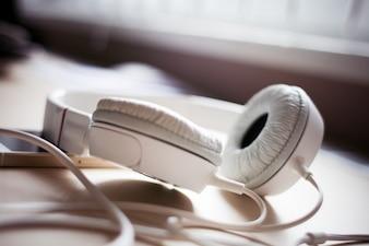 White headphones on the desk