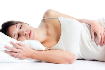 White human face lying down cheerful pillow
