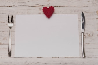 White paper with a heart on top and covered on the sides