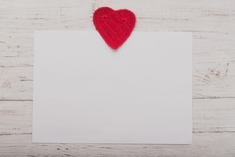 White paper with a heart on top