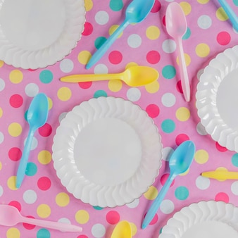 White plates on colorful surface