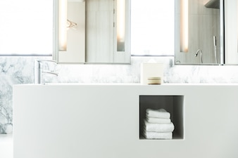 White porcelain sink with towels