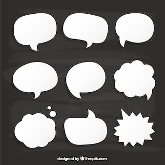 White speech bubbles on cardboard