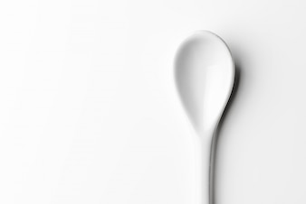 White spoon isolated on a white surface