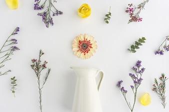 White vase with decorative flowers
