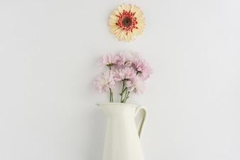 White vase with flowers in purple tones