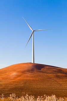 Wind turbine in a hill