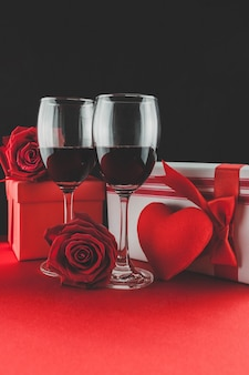 Wine glasses with gifts and a heart