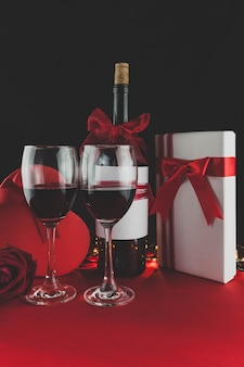 Wine glasses with romantic decoration and gifts