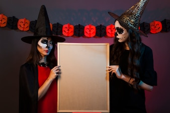 Witches holding whiteboard