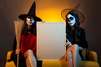 Witches presenting whiteboard