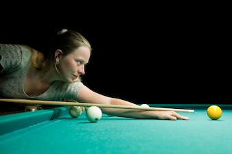 Woman aiming for billiard