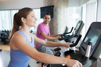 Woman and man on treadmills