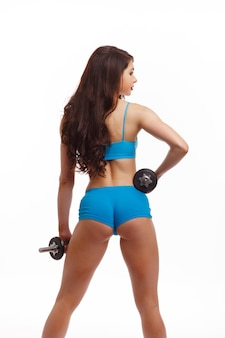 Woman back with dumbbells