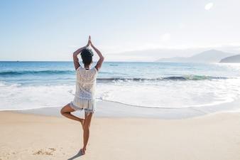 Woman balancing at the beach