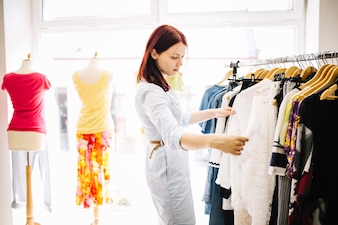 Woman choosing new clothes
