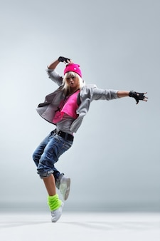 Woman dancing on white background