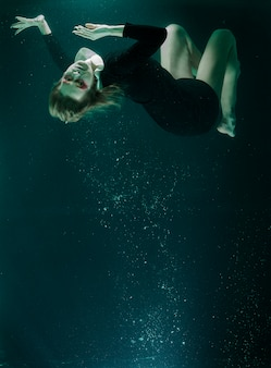 Woman diving in a water tank